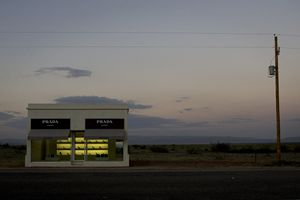 Is it a mirage.  Nope, it's a piece of art in the desert in Texas called Prada Marfa which the creators hope will gradually turn into dust after the looters have taken stuff.  The stuff includes shoes from the Fall 2005 collection.    Prada Marfa