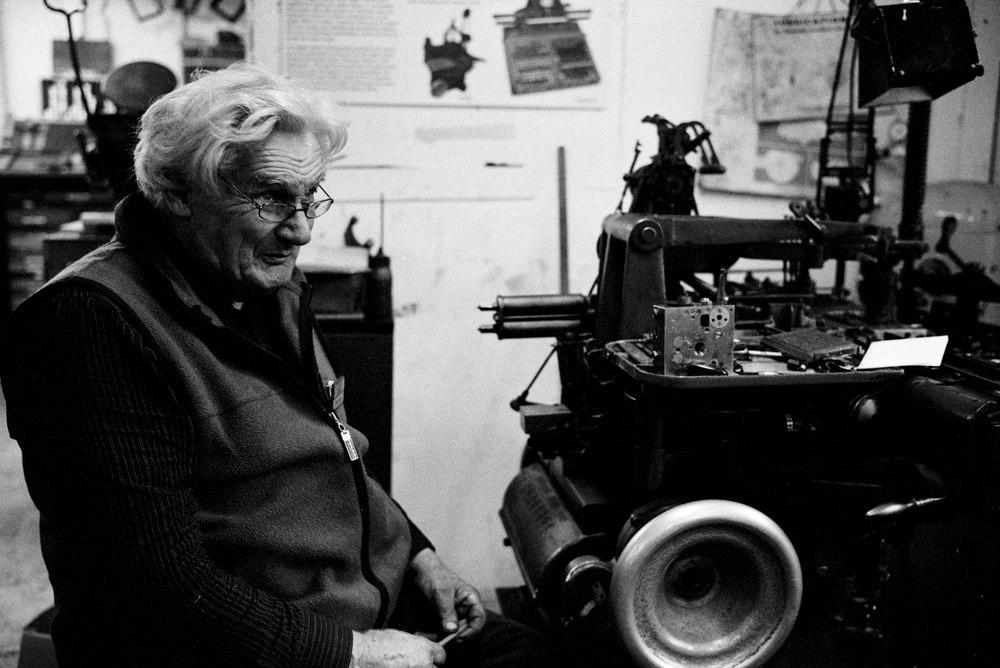 Monotype Mick repairing a Monotype Casting Machine