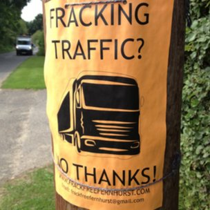 Anti-fracking posters are scattered around the centre of Fernhurst