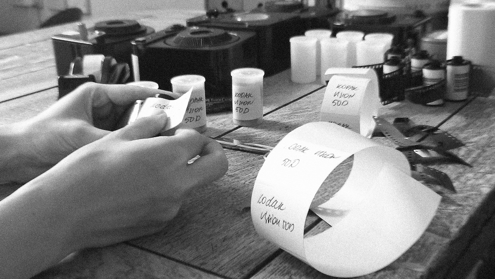 PUTTING LABEL ON EACH 36 EXPOSURE ROLL