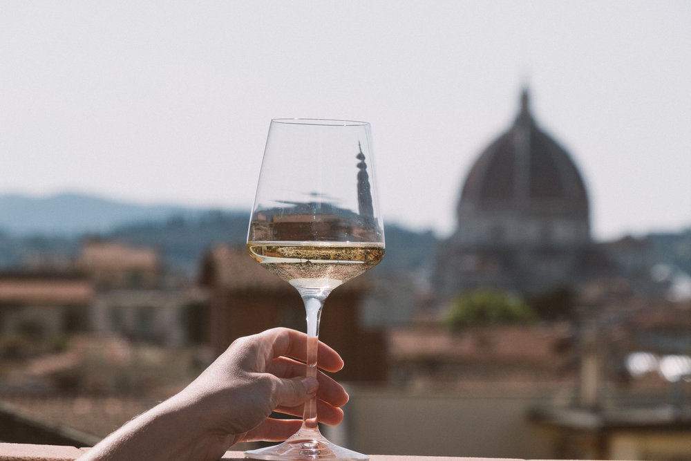 A glass of cold white and the terrace view over Duomo