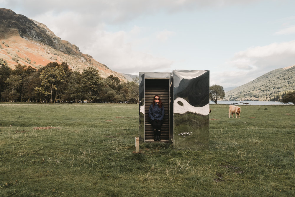 The mirrored cube has carved out volumes that act as seating, to frame the views