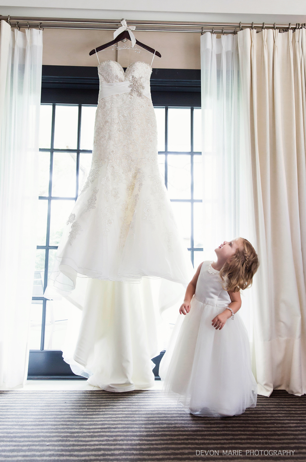 Cameron looking up at her mommy's dress! Love this shot!