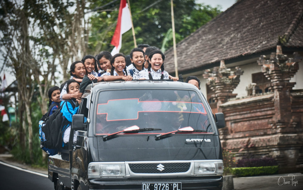 how kids get to and come back from school in Bali, in pure happiness...