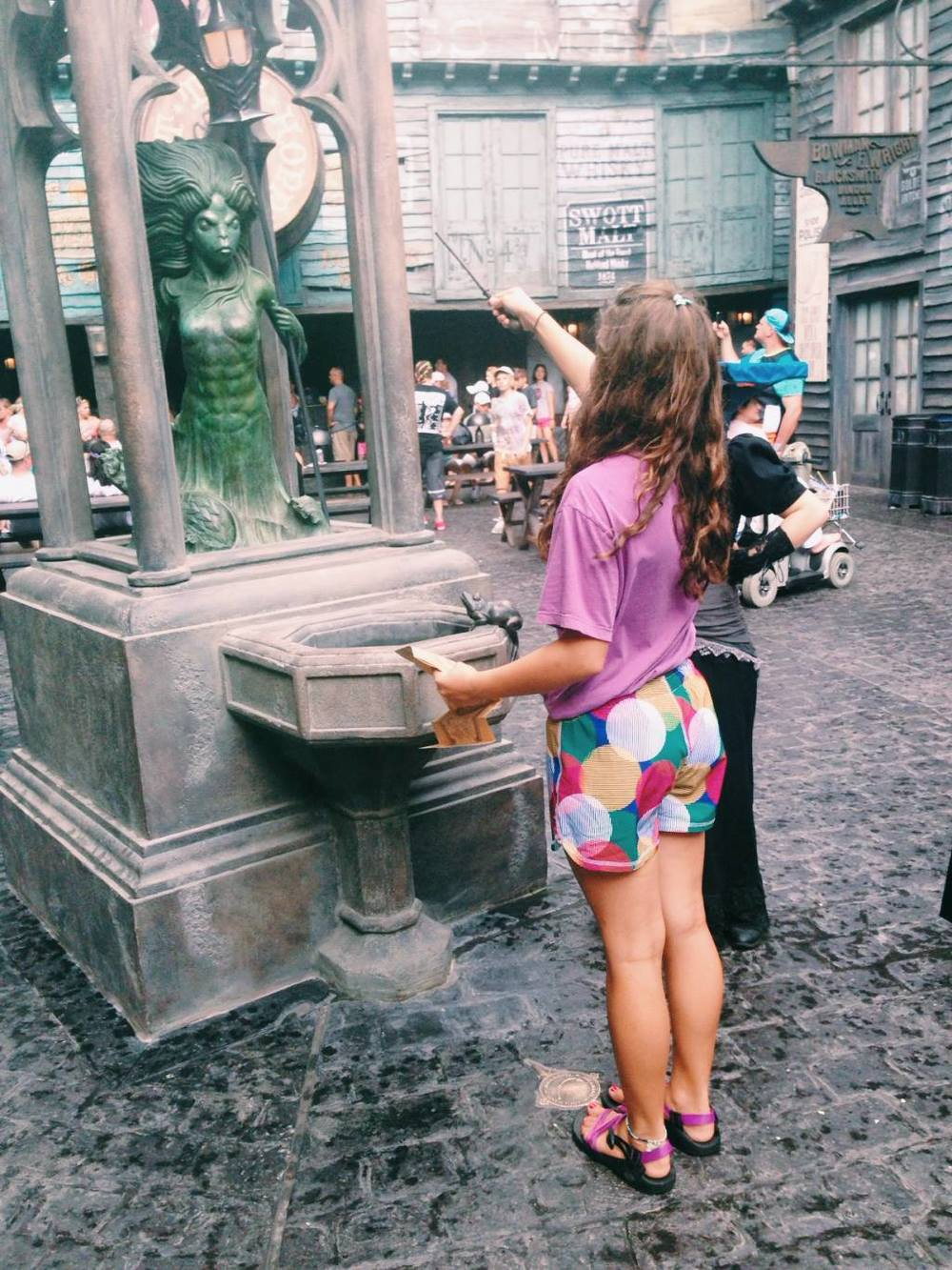 My niece casting spells all around Diagon Alley with her wand. It really works! Brilliant!