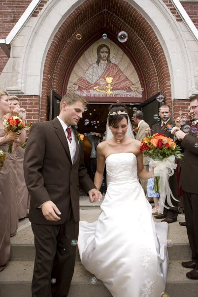 Chris and Ashley on their wedding day (the gown that became the suit)