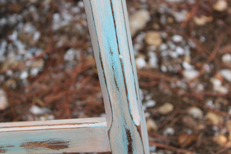 Up close little blue desk distressing