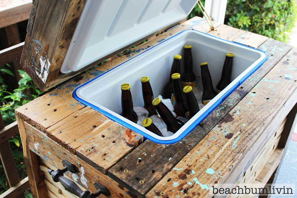Rustic cooler box filled with ice cold beer