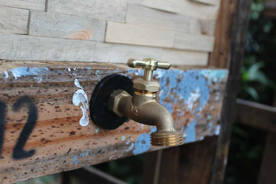 Spigot on the rustic cooler box