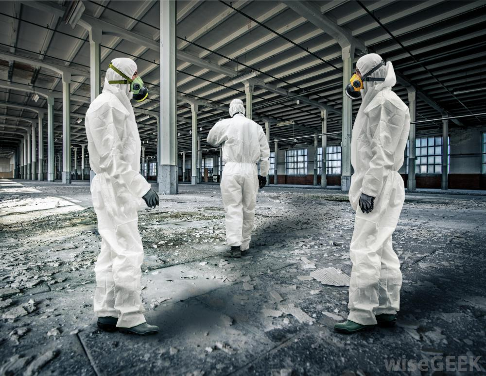 three-people-in-white-toxic-suits-at-empty-site.jpg