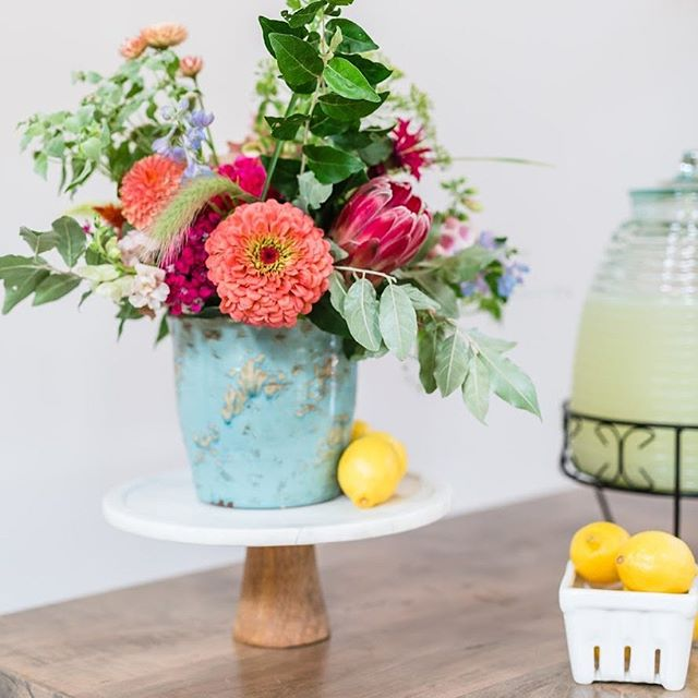 Nothing says summertime like lemonade and fun, colorful flowers! Image by @traci_huffman, Venue & Florals: @barnofchapelhill, Specialty Rental: @cottageluxe, Planning & Design: @tailoredoccasions #barnofchapelhill