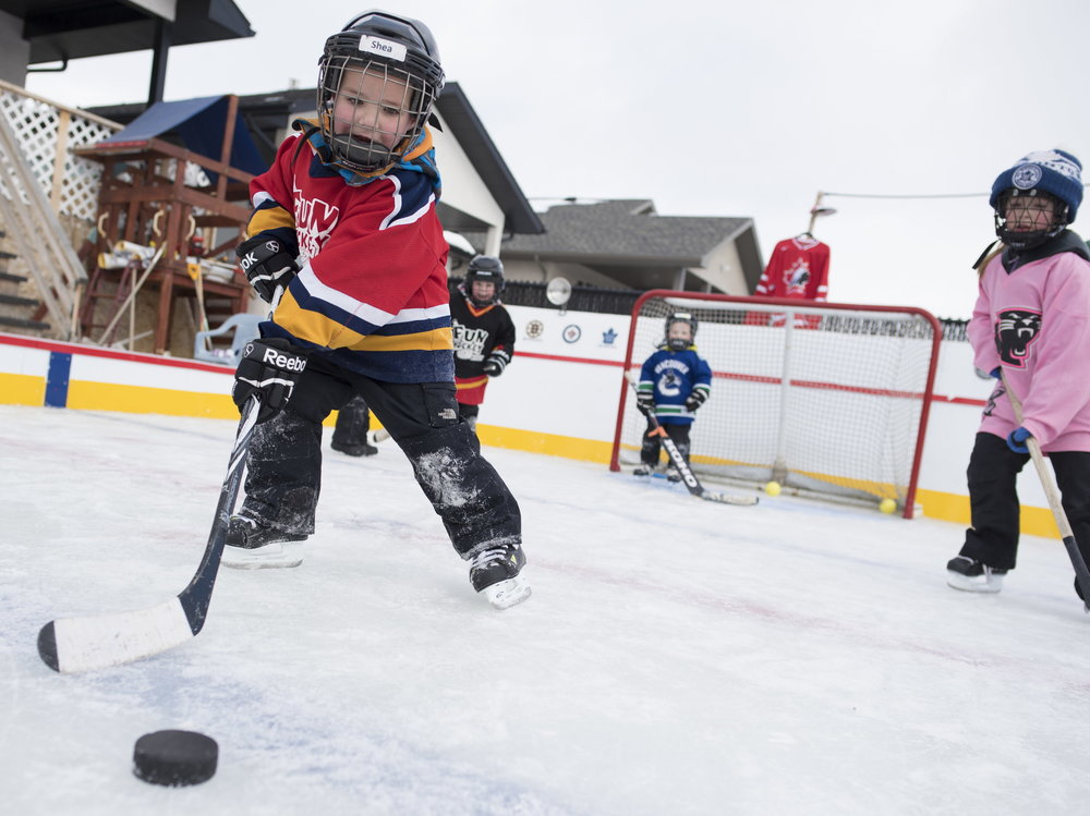 REGINA, SASK : February 16, 2018 - Randy Durovick's grandchildren play hockey on his elaborate backyard hockey rink at his home. MICHAEL BELL / Regina Leader-Post. COPYRIGHT: REGINA LEADER-POST 2018.