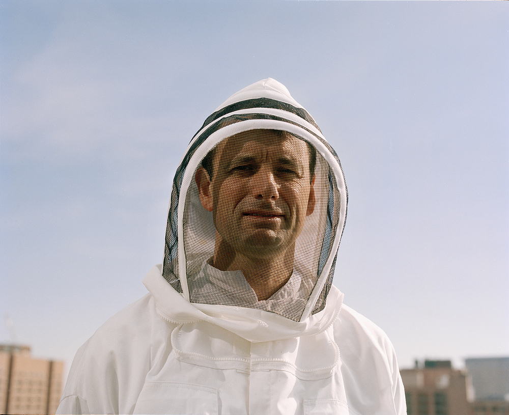 Rooftop Beekeeper, Boston. 2012.