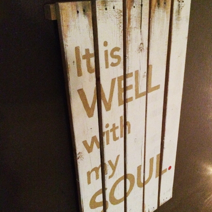 Handpainted signmade from scrapwood.