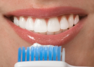 Oral hygiene with a toothbrush and tooth paste
