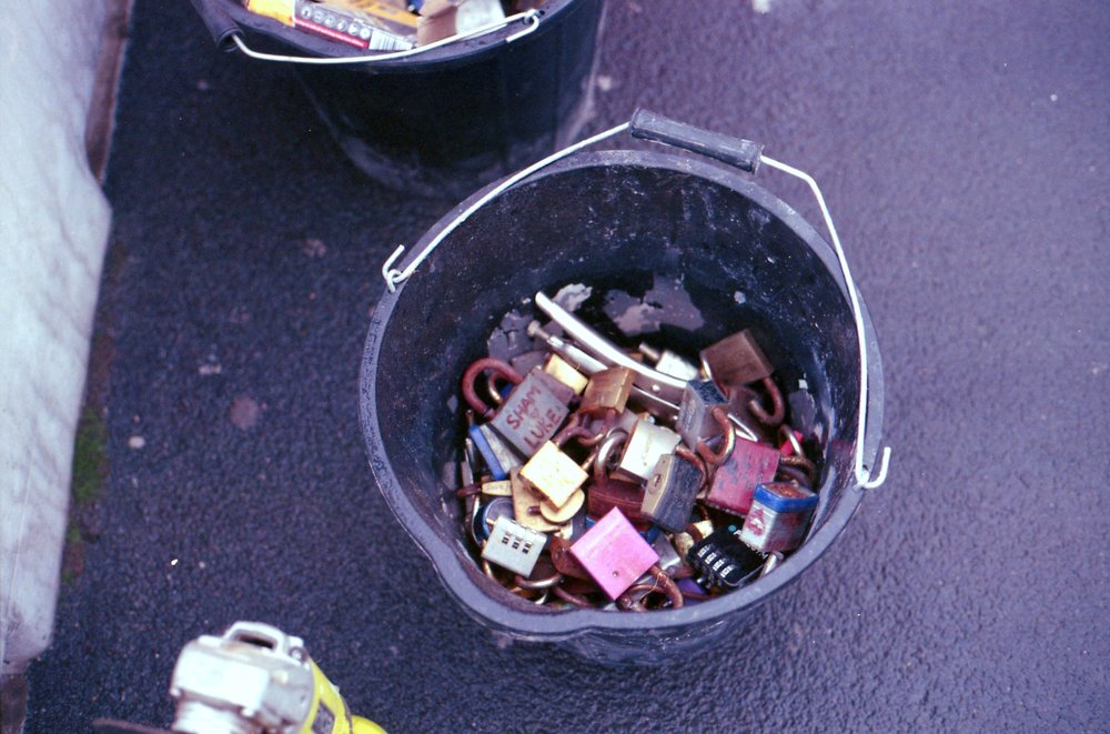 281/366 - Remember  number 5  and  number 120  of this project? Well all the keypads on the bridge across the canal in Leeds have now been removed and the guy removing them was nice enough to say yes to me taking a photo of them all in his bucket. Its a little bit sad to see them all together like that isn't it?