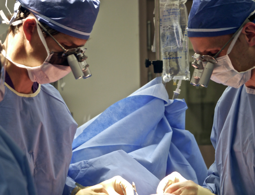 Dr. Mark L. Smith and his colleague Dr. Joseph Dayan operating  together on a lymph node transfer.