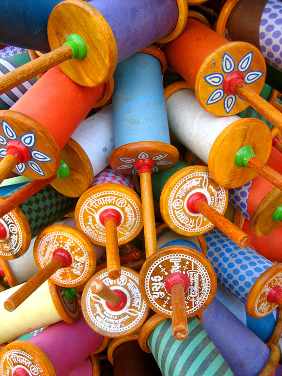 Spools of kite lines, known as  charkhis  Photo credit:  Meena Kadri