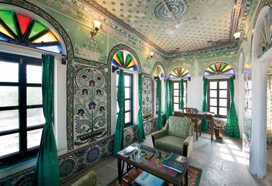 A beautifully restored lounge in Fort Begu displaying frescoes and mirror work