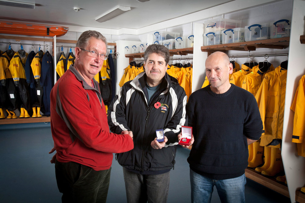 Whitby RNLI Chairman Tom Hardy awards Geoff Hodgson and Nic Botham with long service medals ( 25 & 30 yrs respectively ).
