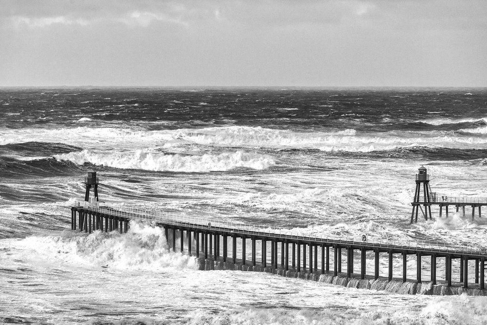 The large swell with a period of 14 seconds, batters Whitby Piers.