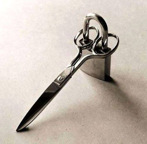 A clever way to keep your scissors on lockdown from wee hands. Protect your fabric scissors!