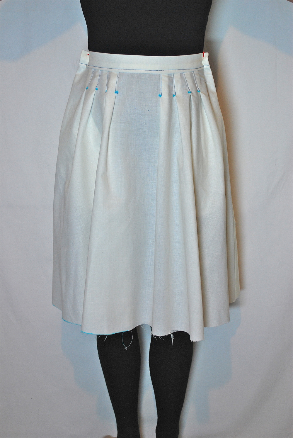 Pictured above is Naomi's toile, the pleated Version 2, in a size 8.