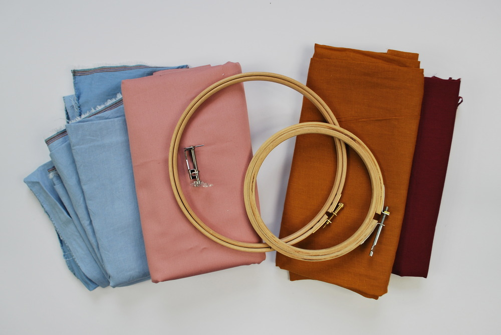 Plain 100% cotton fabrics, embroidery hoops and a free-motion sewing machine foot (otherwise known as a 'darning foot').  Just some of the things you'll use in this workshop.