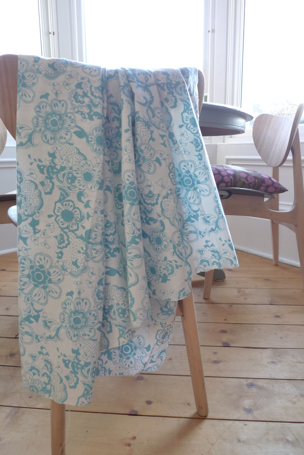 This is a lightweight soft cotton, it drapes well, but it's too flimsy for a cushion.
