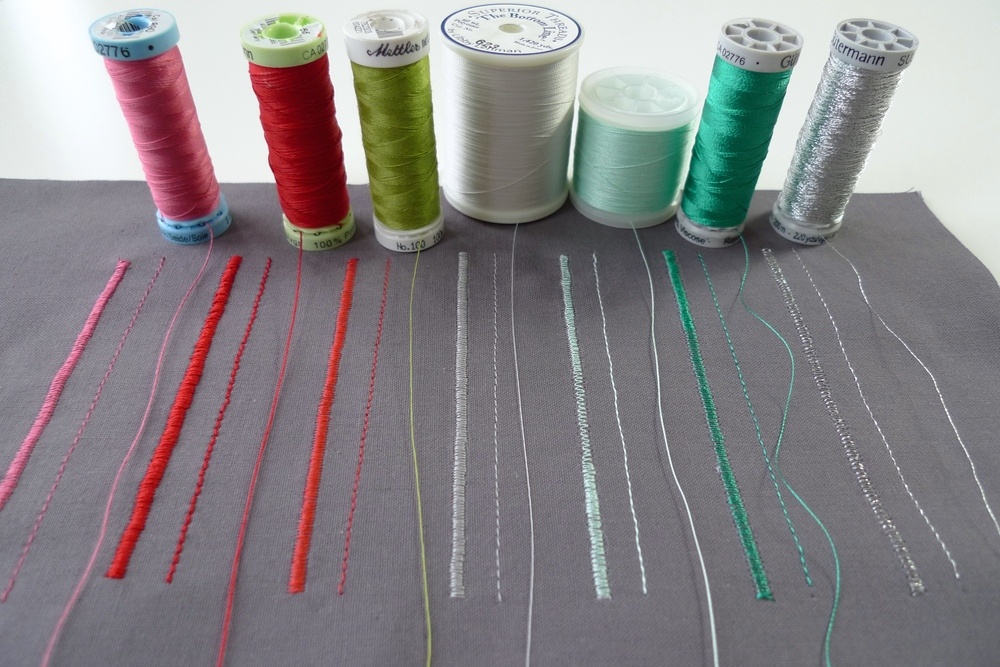Left to right: Gutermann silk, Gutermann polyester topstitch, polyester sew-all Mettler metrosene (red stitching and green thread), Superior 'Bottom Line' extra fine poly, Madeira embroidery cotton, Gutermann rayon embroidery, Gutermann metallic