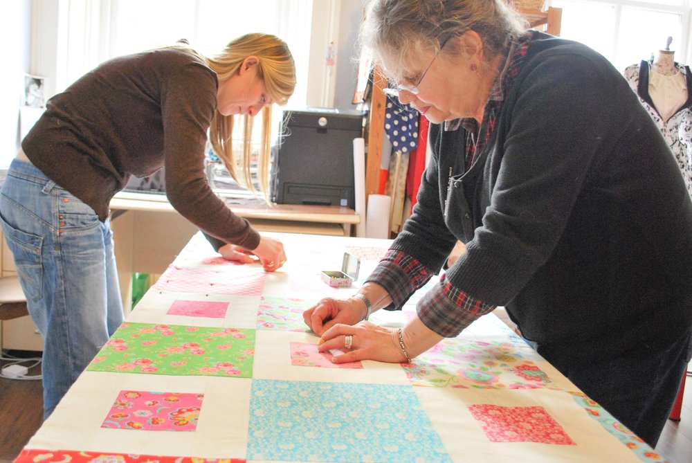 Layering up during one of our quilting courses.