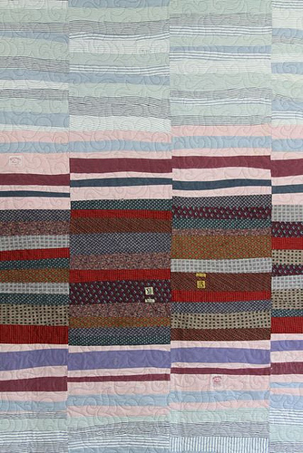 A quilt made of old shirts, ties and trousers. Image courtesy of  Mamaka Mills .
