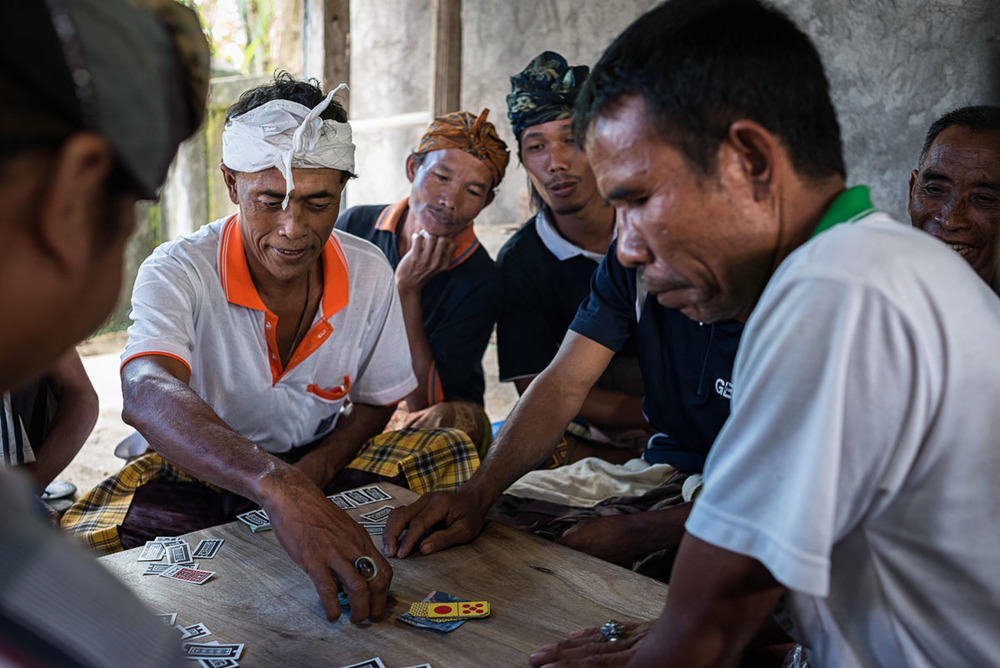 The game looked friendly enough but it was hard to say what kind of stakes they were playing for. I just smiled a lot and smoked Kretek (clove) cigarettes just like everyone else. Bali, Indonesia, Piotrek Ziolkowski, 2013