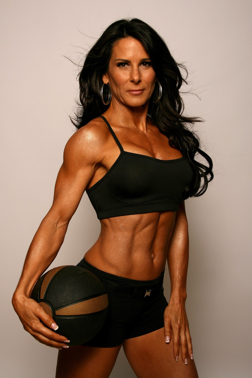 Fitness expert and figure competitor, Laura London, age 47- a mom of 3 who began weightlifting regularly in her 40s. Image:   http://www.lauralondonfitness.com/