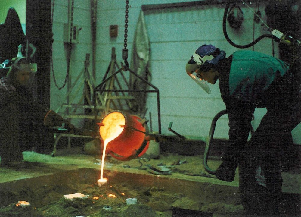 Gregory Mills doing a bronze pour at Appalachian State University's Art Department Foundry circa 1991