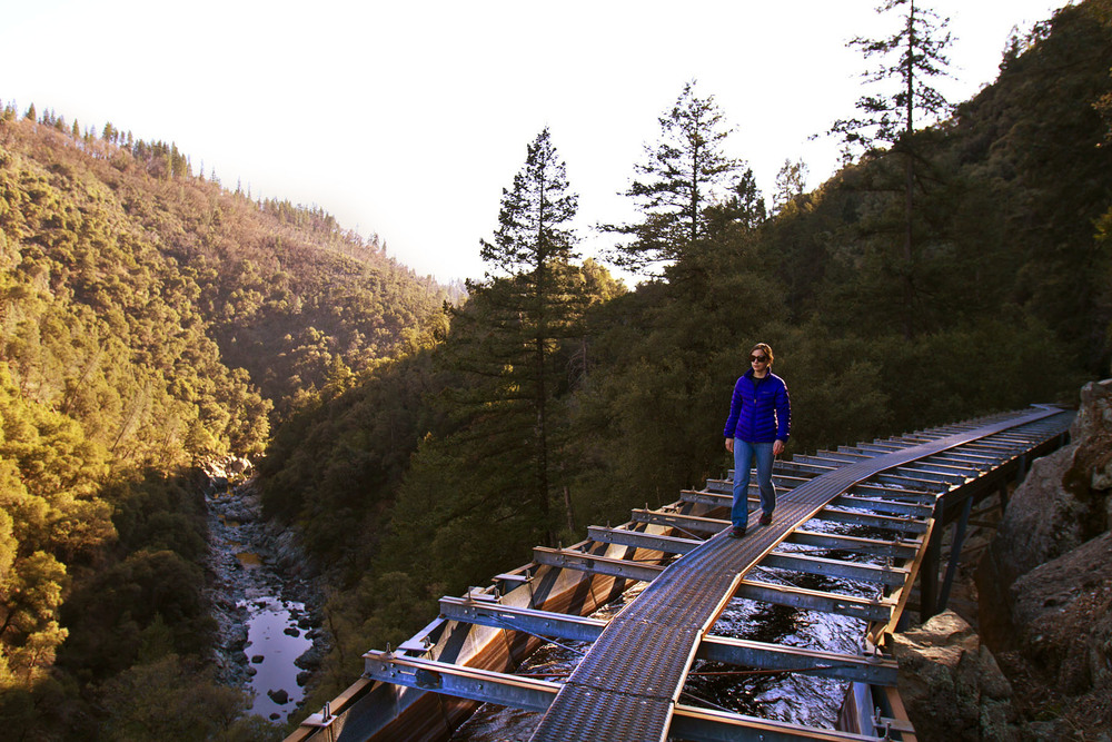 Elizabeth Stuart walks the flume catwalk with the West Branch of the North Fork of the Feather River below.