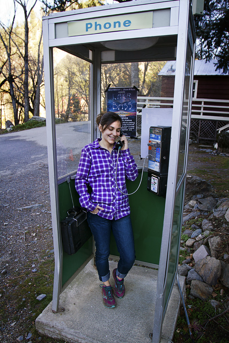Elizabeth Stuart calls home from a phone booth along Highway 70 in Northern California.