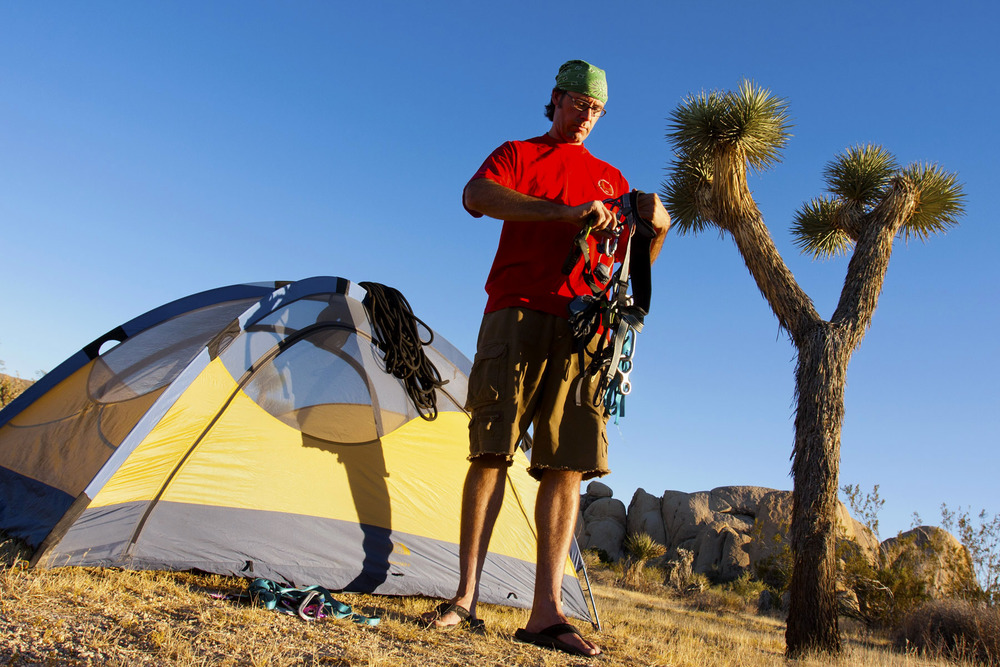 James Halfacre gets ready for a day of climbing in Joshua Tree National Park. Although the park does get crowded and doesn't offer free camping, it does provide a unique backdrop for outdoor activities.