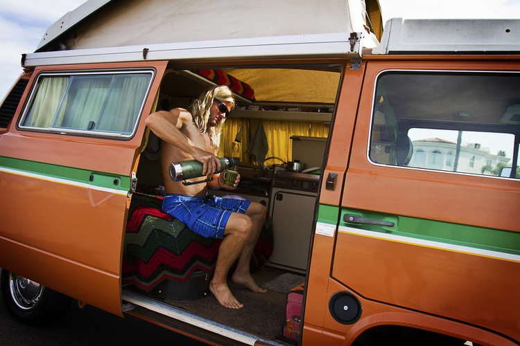 Van life with chad chad pouring his morning coffee after a surf session on sunset cliffs san diego publicscrutiny Choice Image