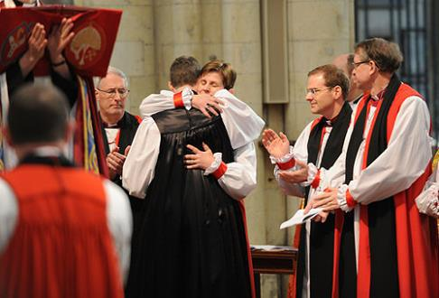 Bishop Lane and Bishop North share an embrace at the latter's consecration.
