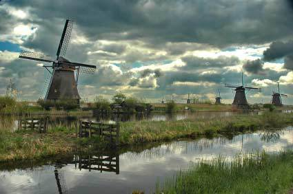 Windmills in Holland before a storm.