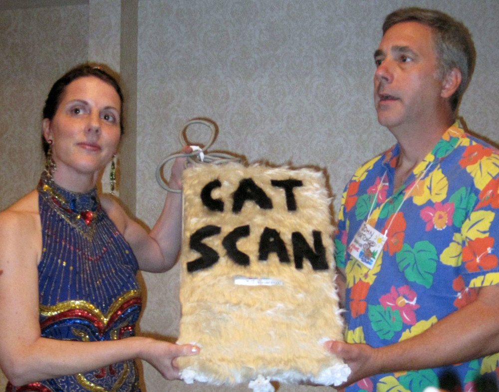 Cat Scan, decoy scanner for your cat. GNSI conference 2011 momentsbefore a vicious bidding war. Sara Taliaferro and John Norton.