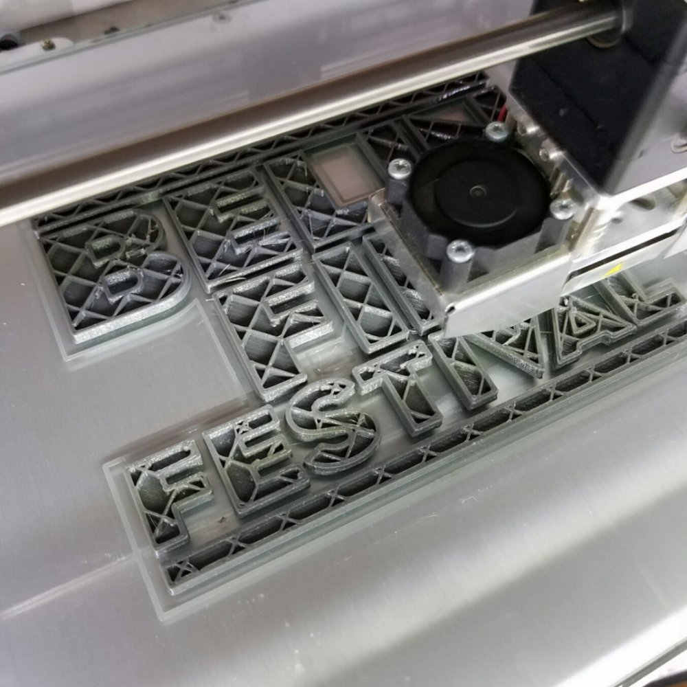 The Belin Film Festival logo in the process of being 3D printed.