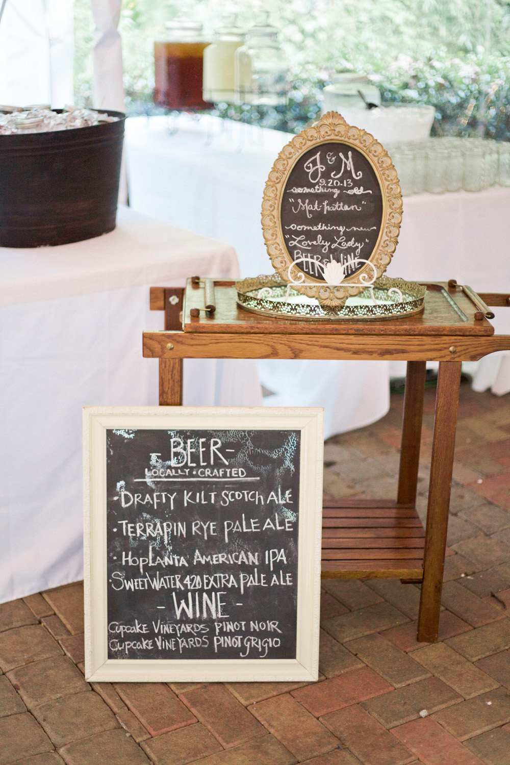 A distressed chalkboard added to the rustic feel of the reception, while an antique bar cart added a touch of class.