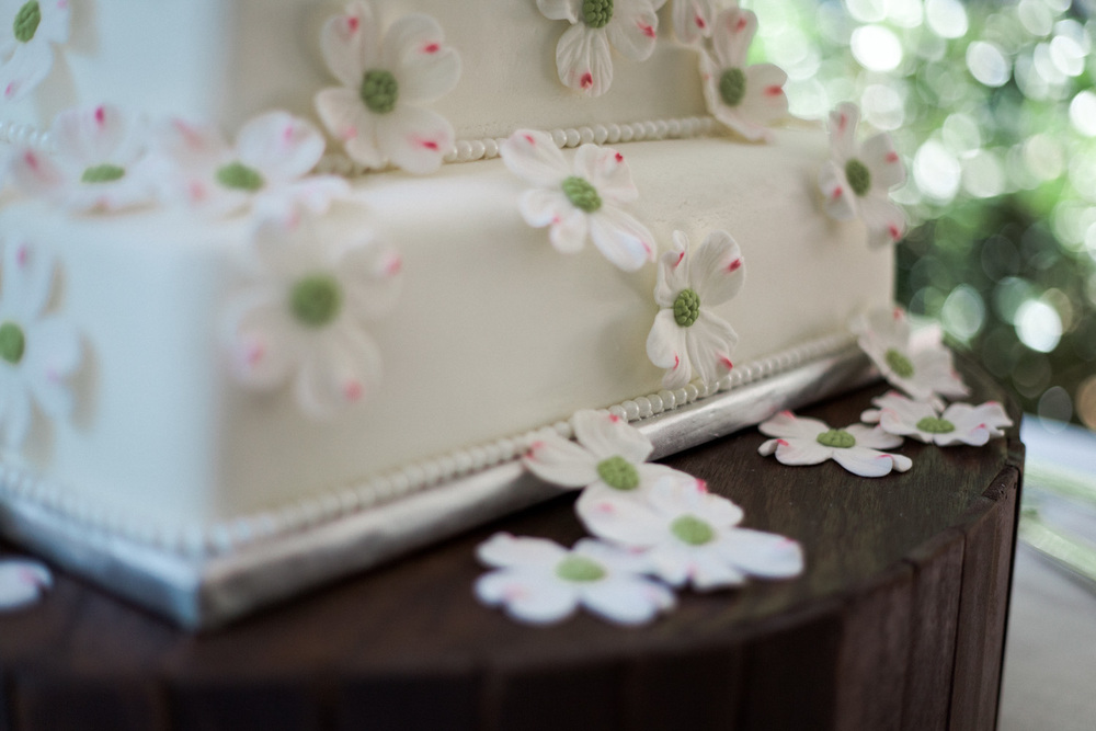 Julia's gorgeous wedding cake looked spectacular on our rustic cake stand.
