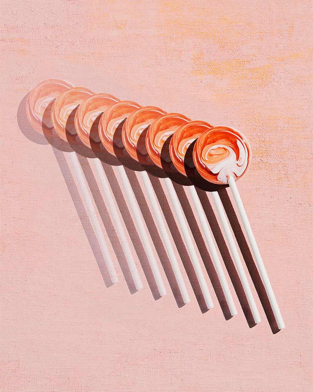 Creamsicle swirl lollipop