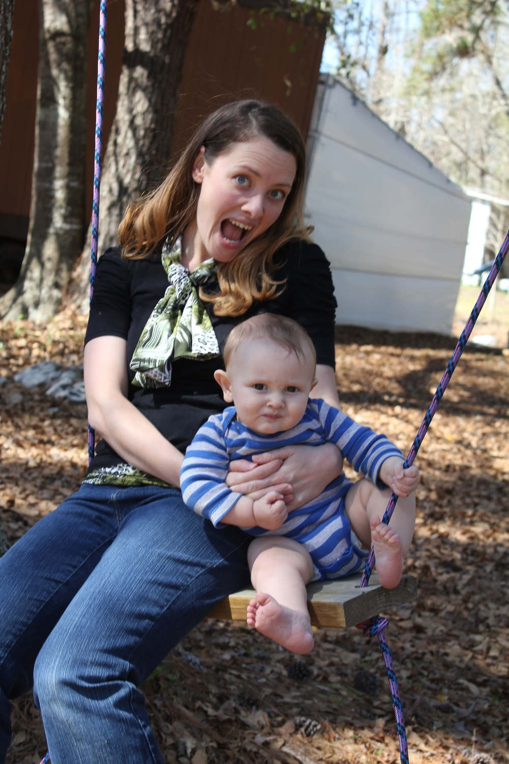 Enjoying the swing that crafty Uncle Durward made a few months back. Judah's not so sure about my swinging skills...
