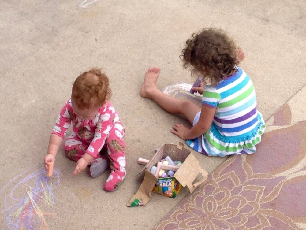 Olivia & Kenzie drawing with chalk in our backyard, practicing those fine motor skills!