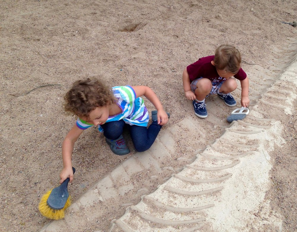 Kenzie & Judah digging for dinosaur bones at the Austin Nature & Science Center - a free resource here in the city.