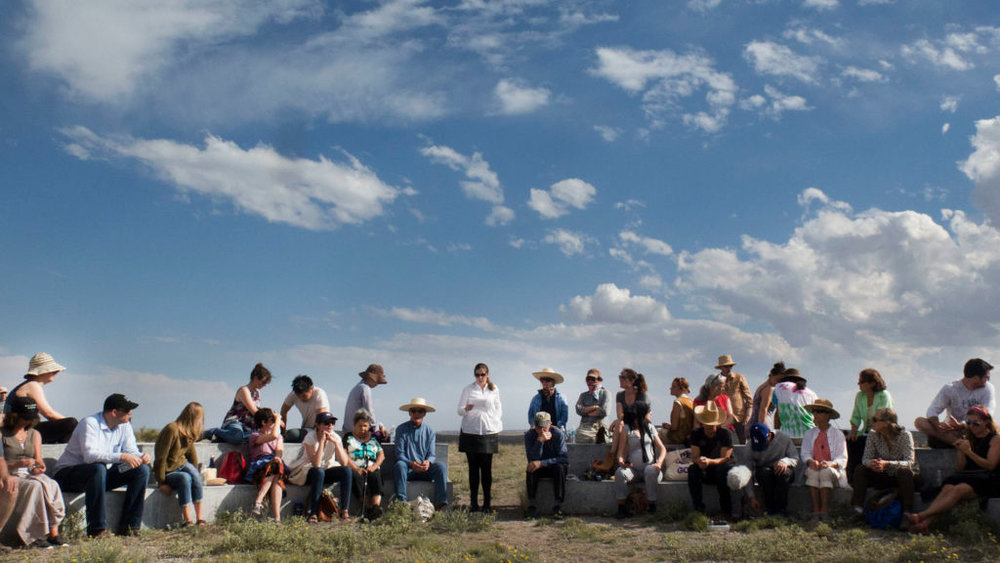 Curator Jennifer Burris Staton introduces a new site-specific Alvin Lucier music composition performed at Mimms Ranch outside of Marfa, Texas in May 2016. Photo: Sarah Vasquez